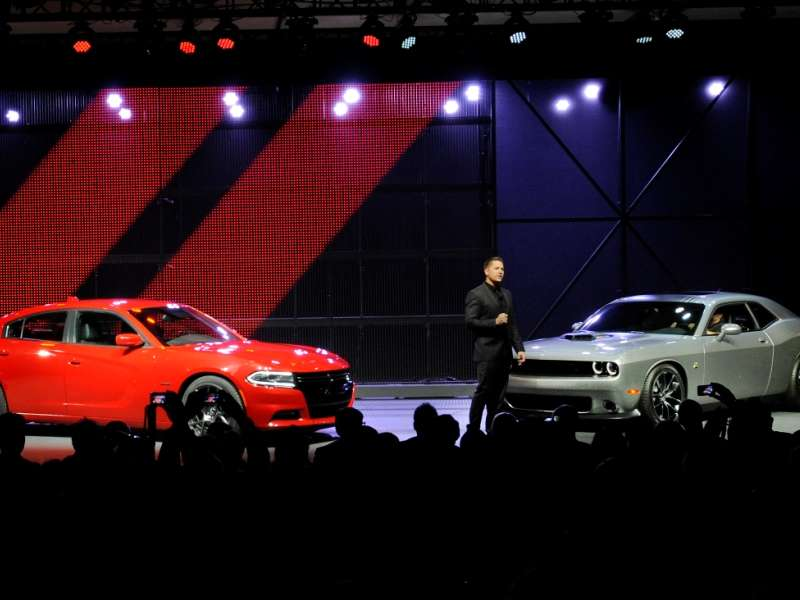 Tweet about 2015 Dodge Charger vs. Challenger, Win NYIAS Media Kit