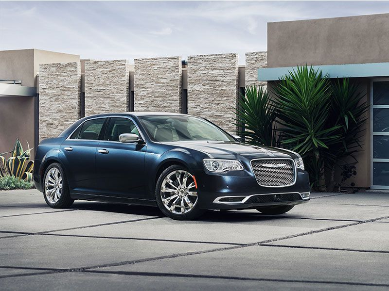 2016 Chrysler 300 in front of house