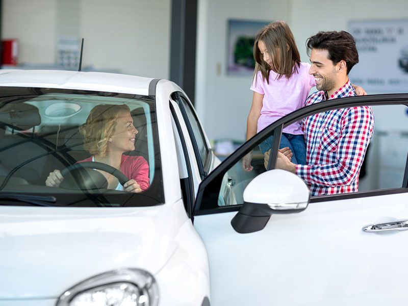 bigstock Happy young family car shopping