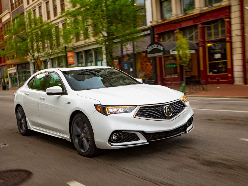 2020 Acura TLX white driving in city