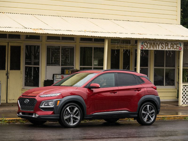 2020 Hyundai Kona red parked near building