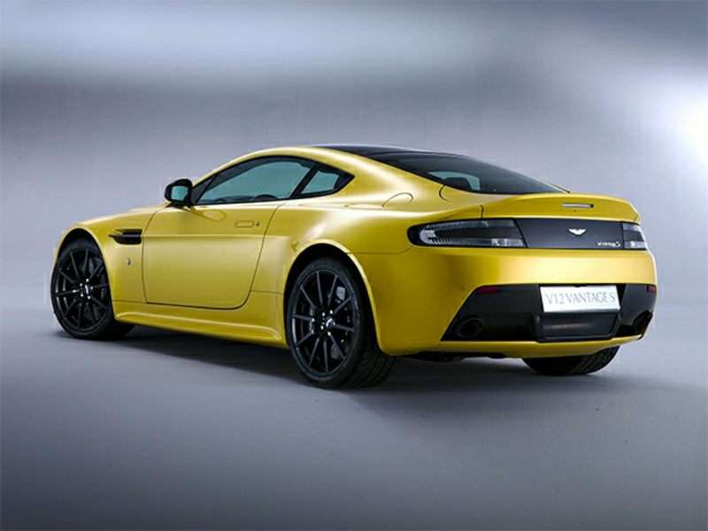 yellow aston martin v12 vantage