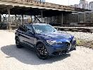 2017 Alfa Romeo Stelvio exterior front angle with grille by Matt Landish