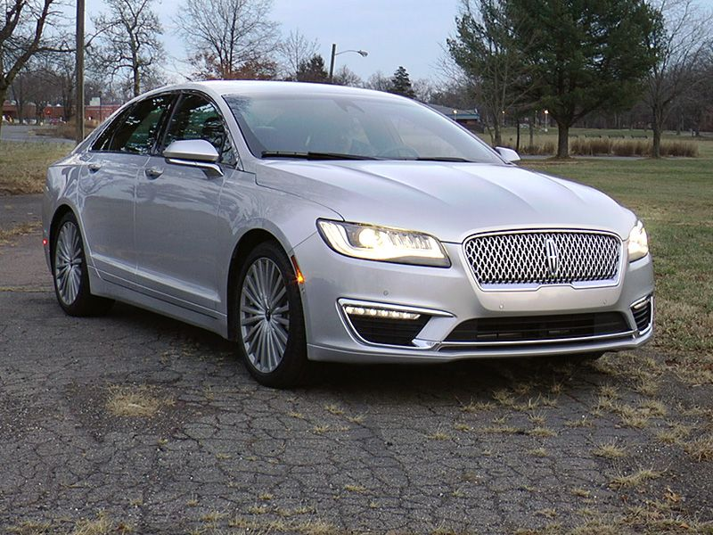 https://img.autobytel.com/car-reviews/autobytel/-2017-lincoln-mkz-road-test-and-review/2017_Lincoln_MKZ_3-4_front_profile_lights_on.jpg