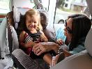 Happy Baby in Car Seat with Mom