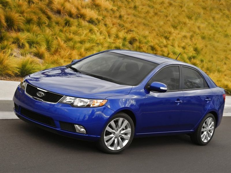 2012 Kia Forte blue driving