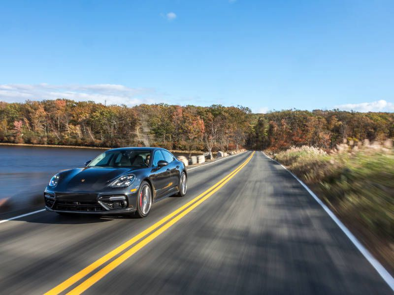 2017 Porsche Panamera front three quarter driving hero