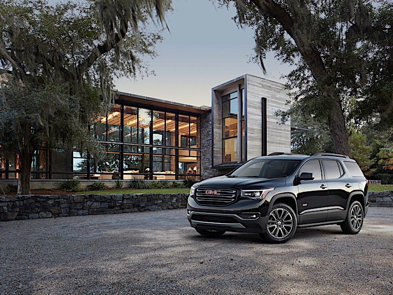 2018 GMC Acadia All Terrain three quarter in front of house