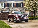 2018 GMC Acadia Denali red parked