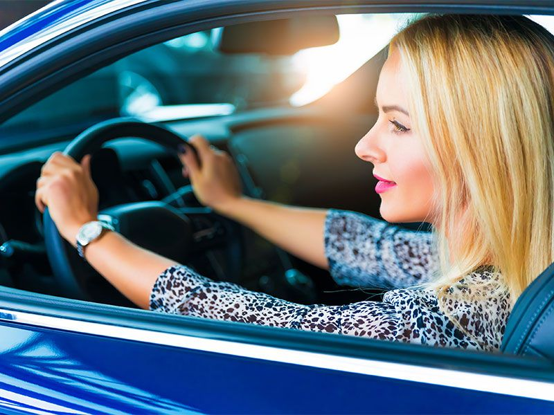 iStock woman driving new car