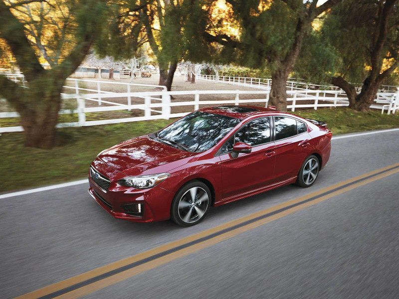 2019 Subaru Impreza red driving