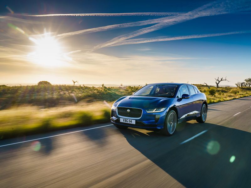 2019 Jaguar I Pace Blue Driving Sunset Front Quarter