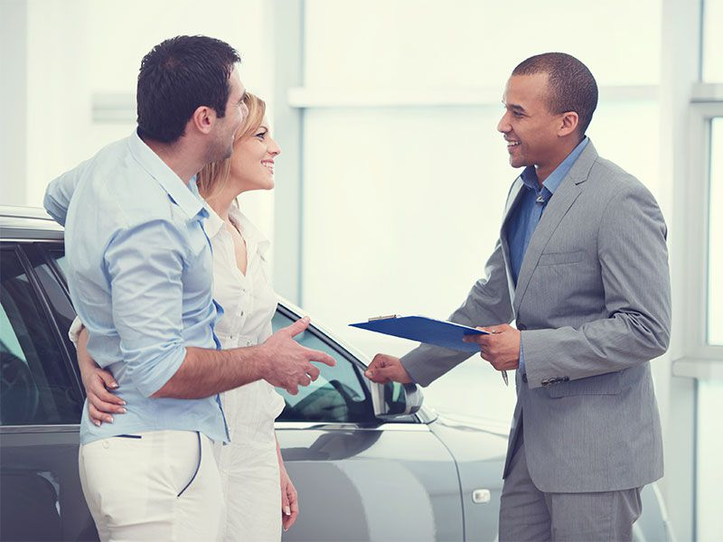 iStock couple with car salesman