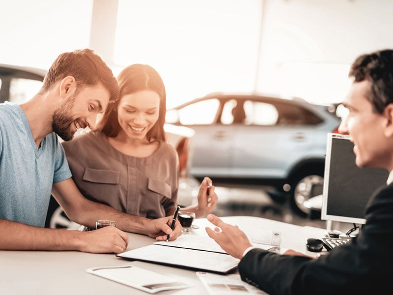 iStock signing papers at dealership