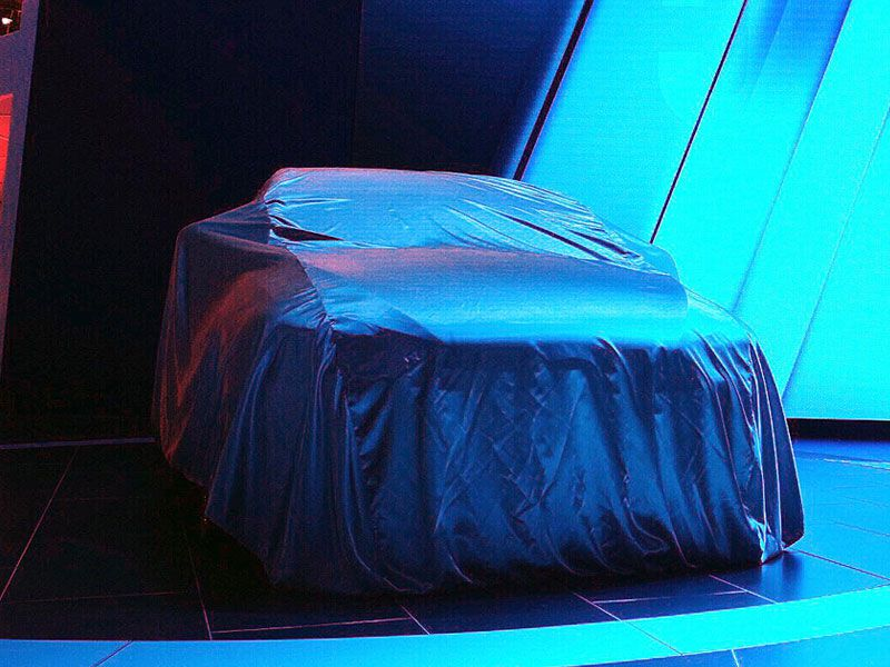 teaser covered car
